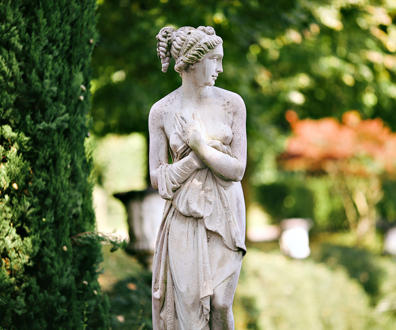 Photo of ancient statue in a classic garden