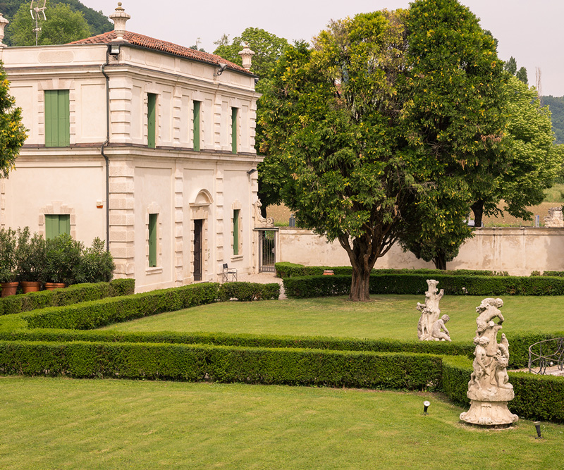 Photo of a historic villa with a classic style garden
